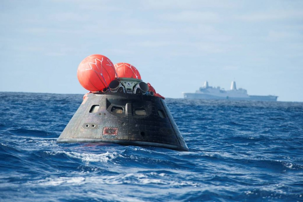 NASA's Orion spacecraft awaits the USS Anchorage after a successful flight test on December 5, 2014