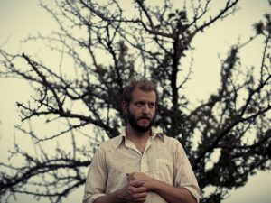 A promotional photo of Bon Iver frontman Justin Veron taken around the time the album was released.