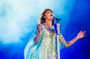 Florence Welch of Florence + the Machine mid song