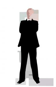 Stubborn man in suit, arms crossed