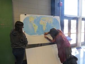 Natasha and Noraya setting up map poster prior before the VA Power Dialogue