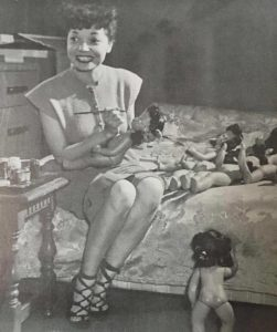 Pioneering cartoonist, Zelda 'Jackie' Ormes with her Patty Jo doll.