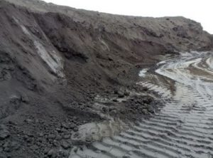 Mounds of coal ash at the Dominion power plant