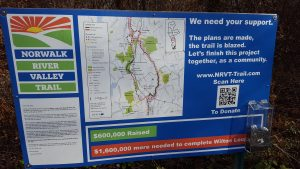 "Signage along the trail urges residents to""finish this project together, as a community."""