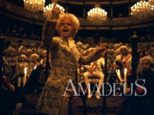 "Actor Tom Hulce plays ""Wolfie"" in the 1984 film adaptation of Peter Shaffer's play ""Amadeus."""