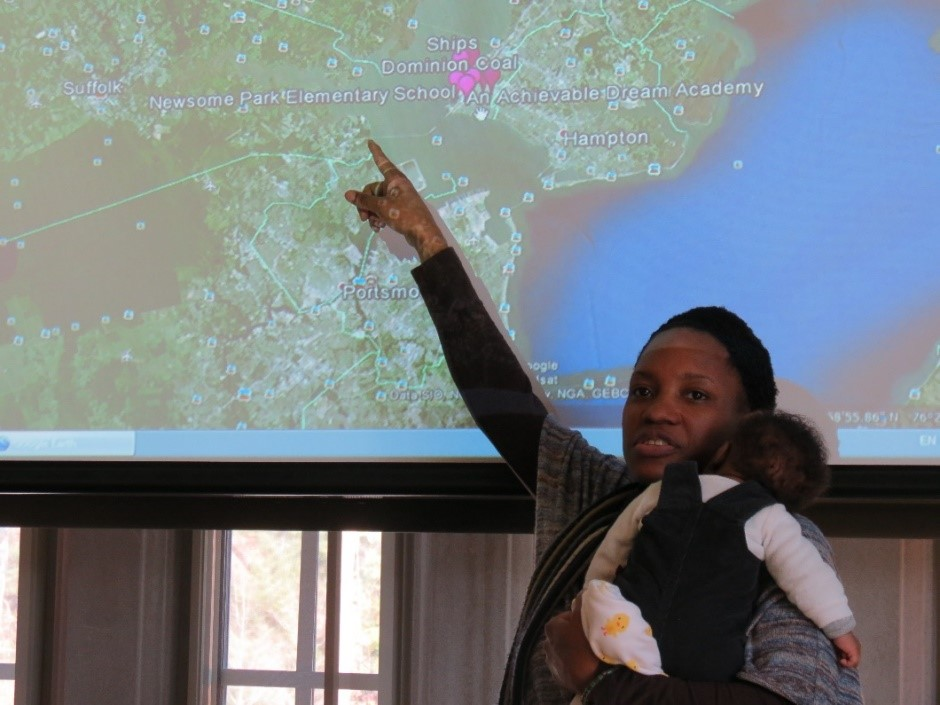 Dr. Erica Holloman, Program Coordinator for the Southeast Care Coalition and her newborn son