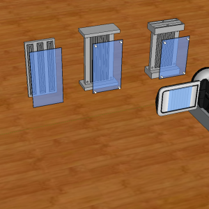 Four prototypes of the flytrack starting with a raceway approach and then leading to the final design with a sample video camera for recording.