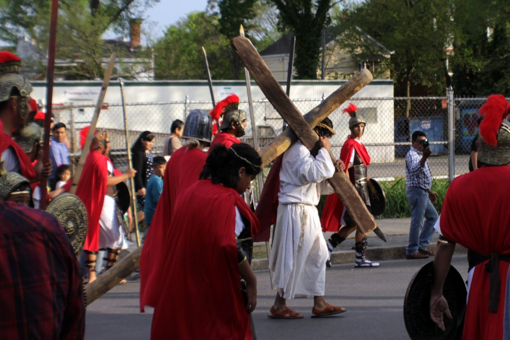 Hundreds of spectators watch on Easter morning as an actor playing Jesus carries the cross to Pontius Pilate's house. (Photo by Thess Pfferr)