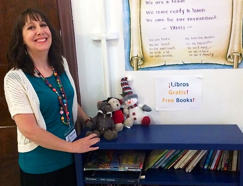 Elaine Hinkle stands next to the books and toys the center has for children. They all are free to take home. (Photo by Thess Pfferr)