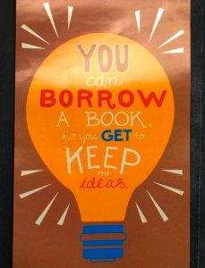 A poster at the Sacred Heart Center library encourages new readers. (Photo by Thess Pfferr)