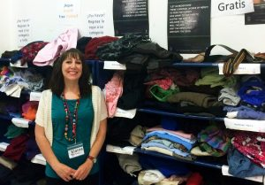 The Sacred Heart Center has also stands where people can donate and pick up clothes, next to them is, Elaine Hinkle. Photo by Thess Pfferr